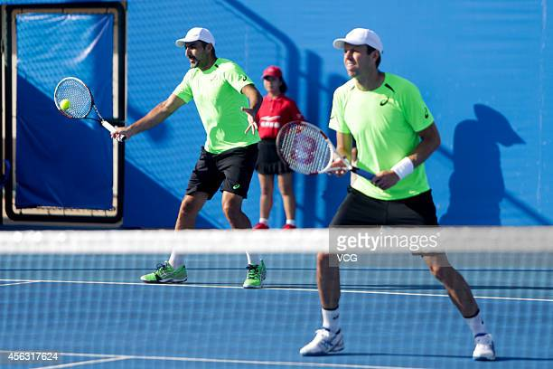 Daniel Nestor of Canada and Nenad Zimonjic of Serbia and Montenegro competes with Fabio Fognini of Italy and Florian Mayer of Netherlands during day...
