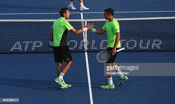 Daniel Nestor of Canada and Nenad Zimonjic of Serbia celebrate the win during their Mens Doubles match against Novak Djokovic of Serbia and Stan...