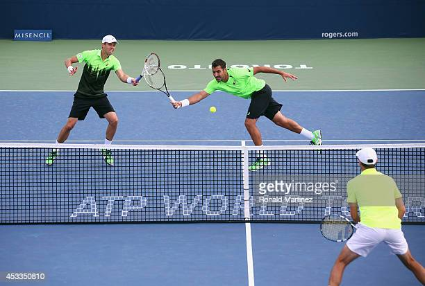 Daniel Nestor of Canada and Nenad Zimonjic of Serbia during their Mens Doubles match against Julien Benneteau and Edouard RogerVasselin of France...