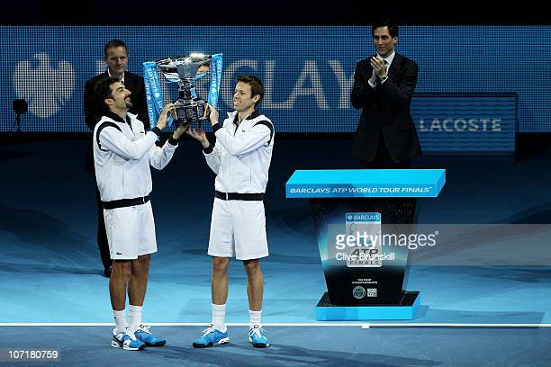 Daniel Nestor of Canada and Nenad Zimonjic of Serbia hold the trophy presented by CE of Barclays Global Retail Banking Antony Jenkins and ATP...