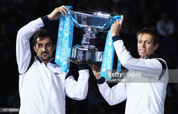 Daniel Nestor of Canada and Nenad Zimonjic of Serbia hold the trophy as they celebrate winning the men's doubles final match against Mahesh Bhupathi...