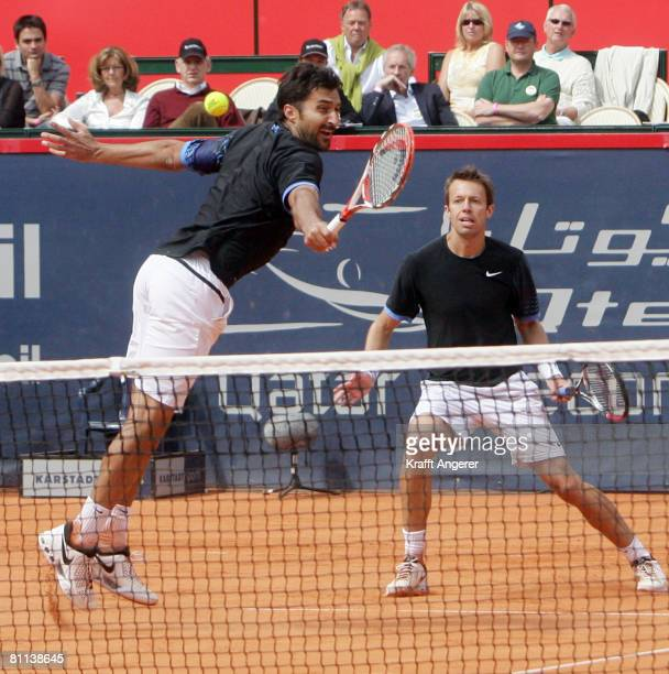 Daniel Nestor of Canada and Nenad Zimonjic of Serbia in action during the final double match against Bob and Mike Bryan of USA during day seven of...