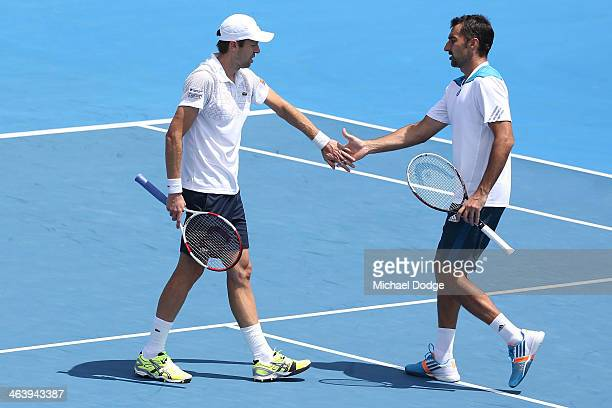 Daniel Nestor of Canada and Nenad Zimonjic of Serbia in action in their third round doubles match against Mariusz Fyrstenberg of Poland and Marcin...