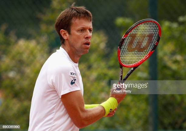 Daniel Nestor of Canada partner of Fabrice Martin of France looks on during the mens doubles first round match against Santiago Gonzalez of Mexico...
