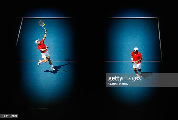 Daniel Nestor of Canada plays a forehand in his semifinal doubles match with Nenad Zimonjic of Serbia against Ivo Karlovic of Croatia and Dusan Vemic...