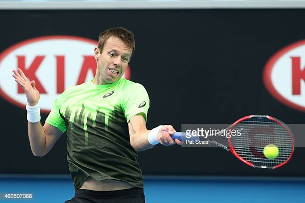 Daniel Nestor of Canada plays a forehand in their semifinal mixed doubles match with Kristina Mladenovic of France against Sania Mirza of India and...
