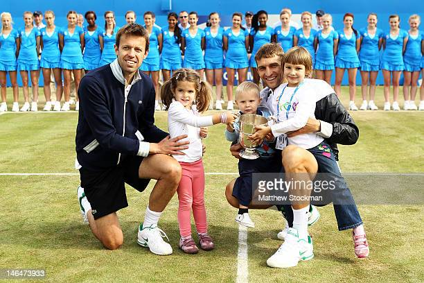 Daniel Nestor of Canada with daughter Tiana and Max Mirnyi of Belarus with son Demid and daughter Petra after winning their mens double final round...