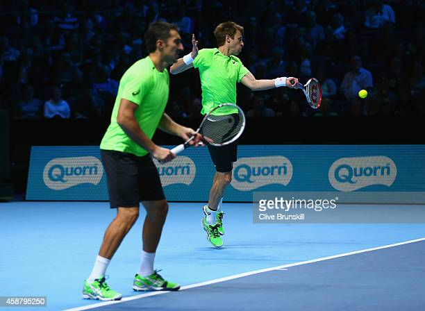 Daniel Nestor of Canadaand Nenad Zimonjic of Serbia in action against Julien Benneteau of France and Edouard RogerVasselin of France in the round...