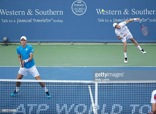 Daniel Nestor serves the ball as Vasek Pospisil plays the net in the match against PierreHugues Herbert and Nicolas Mahut of France which they won 64...