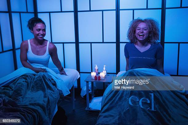 Daniel Nicolet and Rachel Crow pose for a photo after a Zeel massage in the Tone It Up Wellness Loung during the Sundance Film Festival on January...