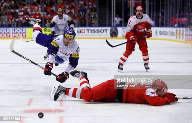 Daniel Nielsen of Denmark and Sanghoon Shin of Korea battle for the puck during the 2018 IIHF Ice Hockey World Championship Group B game between...