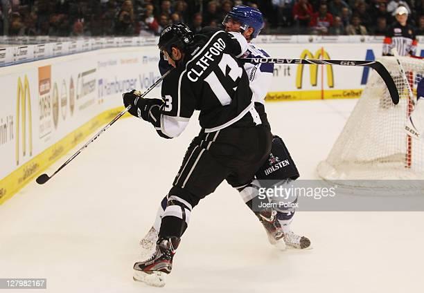 Daniel Nielsen of Hamburg tackles Kyle Clifford of Los Angeles during the NHL PreSeason game between Hamburg Freezers and Los Angeles Kings at the O2...