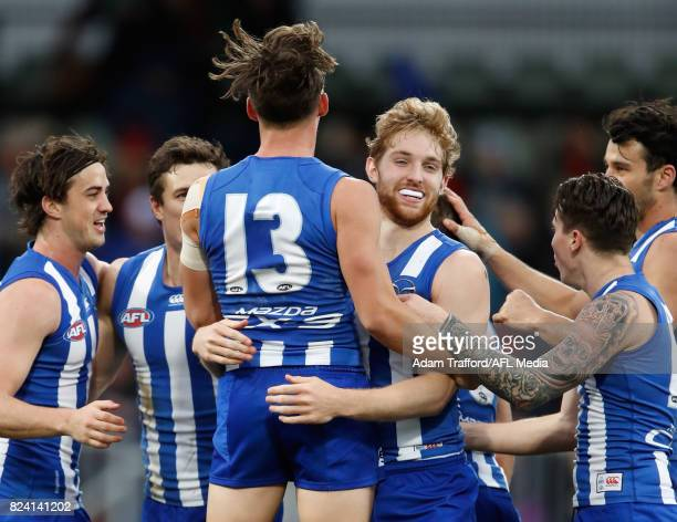 Daniel Nielson of the Kangaroos celebrates on the final siren with Ryan Clarke of the Kangaroos during the 2017 AFL round 19 match between the North...