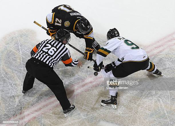 Daniel Nikandrov of the Sarnia Sting takes a faceoff against Kyle Platzer of the London Knights during an OHL game at Budweiser Gardens on December...