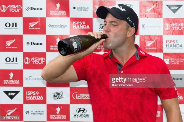 Daniel Nisbet of Australia drinks champagne after winning the Brodie Breeze Challenge Cup during day four of the ISPS Handa New Zealand Golf Open at...