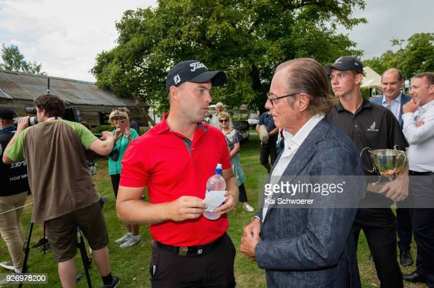 Daniel Nisbet of Australia is congratulated by Sir Michael Hill after winning the Brodie Breeze Challenge Cup during day four of the ISPS Handa New...