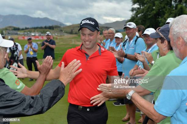 Daniel Nisbet of Australia is congratulated by volunteers after winning the Brodie Breeze Challenge Cup during day four of the ISPS Handa New Zealand...
