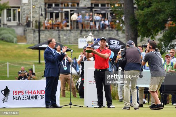 Daniel Nisbet of Australia lifts the Brodie Breeze Challenge Cup during day four of the ISPS Handa New Zealand Golf Open at Millbrook Golf Resort on...