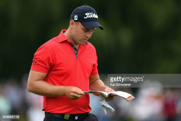 Daniel Nisbet of Australia looks down at his scorecard during day four of the ISPS Handa New Zealand Golf Open at Millbrook Golf Resort on March 4...