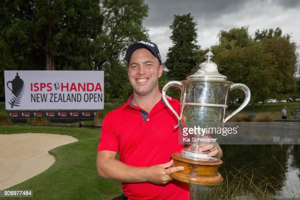 Daniel Nisbet of Australia poses with the Brodie Breeze Challenge Cup during day four of the ISPS Handa New Zealand Golf Open at Millbrook Golf...