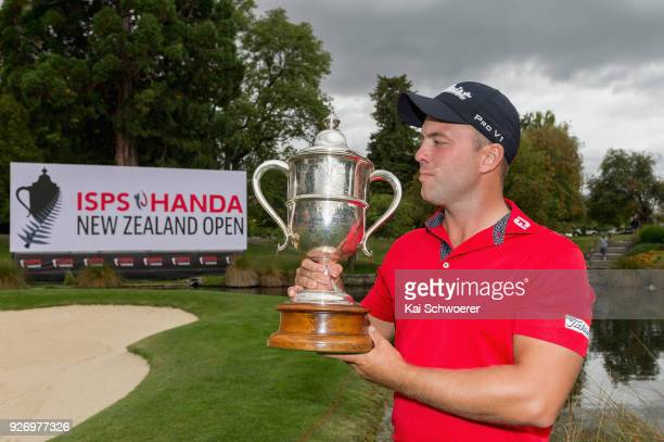 Daniel Nisbet of Australia takes a look at the Brodie Breeze Challenge Cup during day four of the ISPS Handa New Zealand Golf Open at Millbrook Golf...