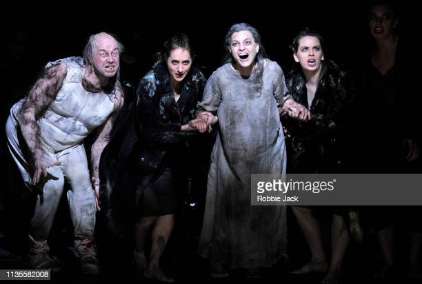 Daniel Norman as Monostatos and Julia Bauer as Queen of the Night with artists of the company in English National Opera's production of Wolfgang...