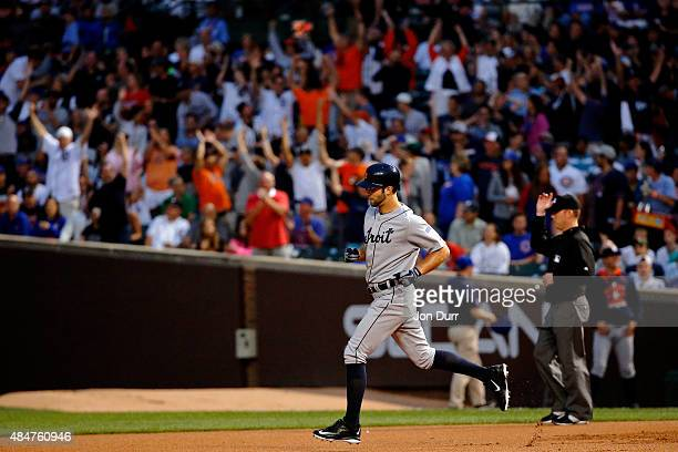 Daniel Norris of the Detroit Tigers rounds the bases after htting a home run against the Chicago Cubs during the second inning at Wrigley Field on...