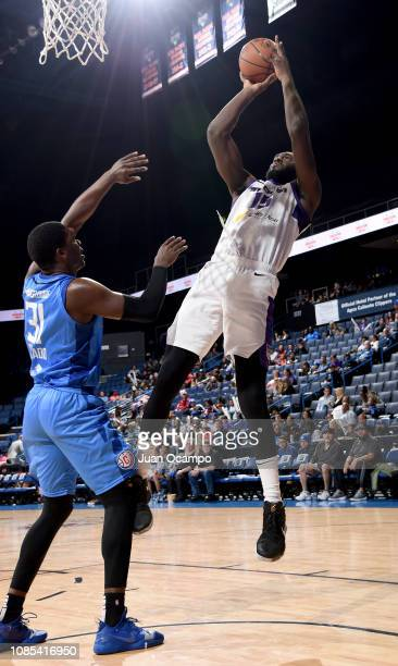 Daniel Ochefu of the Stockton Kings shoots the jumper over Angel Delgado of the Agua Caliente Clippers of Ontario on January 19 2019 at Citizens...
