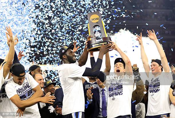 Daniel Ochefu of the Villanova Wildcats and Ryan Arcidiacono hoist the trophy after the Villanova Wildcats defeat the North Carolina Tar Heels 7774...
