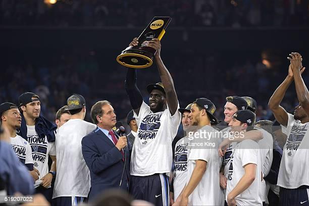 Daniel Ochefu of the Villanova Wildcats hoists the trophy following their 7774 victory against the North Carolina Tar Heels during the 2016 NCAA...