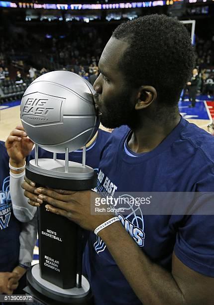 Daniel Ochefu of the Villanova Wildcats kisses the Big East regular Season Championship trophy after defeating the Georgetown Hoyas 84-71 in an NCAA...