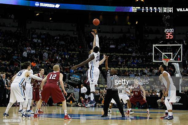Daniel Ochefu of the Villanova Wildcats tips off against Dan Trist of the Lafayette Leopards to start the first half during the second round of the...