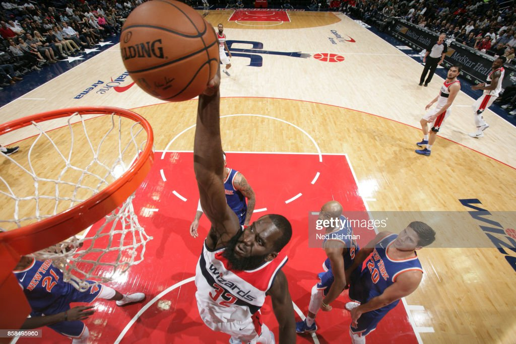 Daniel Ochefu #32 of the Washington Wizards dunks against the New York Knicks during the preseason game on October 6, 2017 at Capital One Arena in Washington, DC.