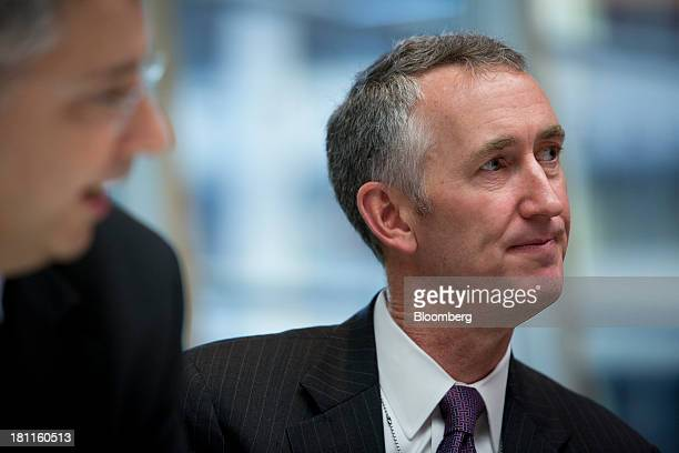 Daniel O'Day head of the pharmaceutical division for Roche Holding AG listens during an interview in New York US on Thursday Sept 19 2013 Roche...