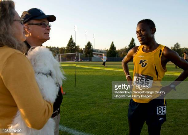 Daniel Okabe right speaks with his host parents Deborah and Terry Innis left after he completed a cross country race at Cal State Fullerton...