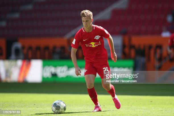 Daniel Olmo Carvajal of Leipzig runs with the ball during the Bundesliga match between FC Augsburg and RB Leipzig at WWK-Arena on June 27, 2020 in...
