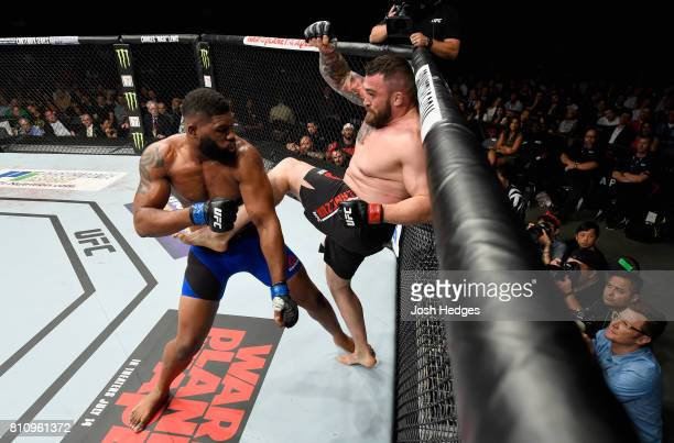 Daniel Omielanczuk of Poland kicks Curtis Blaydes in their heavyweight bout during the UFC 213 event at TMobile Arena on July 8 2017 in Las Vegas...