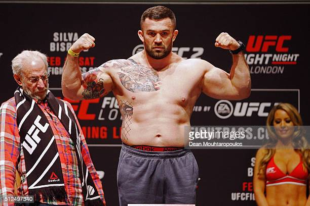 Daniel Omielanczuk of Poland poses on the scales on stage during the UFC Fight Night Weighin held at at Indigo at The O2 Arena on February 26 2016 in...