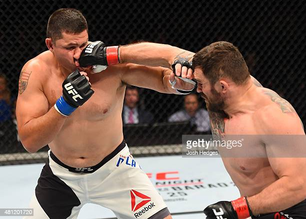 Daniel Omielanczuk of Poland punches Chris De La Rocha of the United States in their heavyweight fight during the UFC Fight Night event inside the...