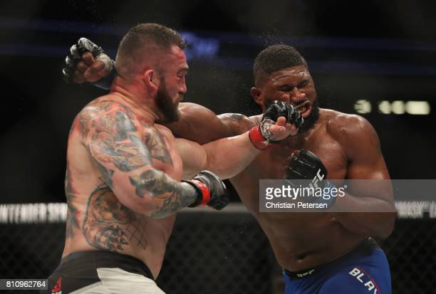 Daniel Omielanczuk of Poland punches Curtis Blaydes in their heavyweight bout during the UFC 213 event at TMobile Arena on July 8 2017 in Las Vegas...