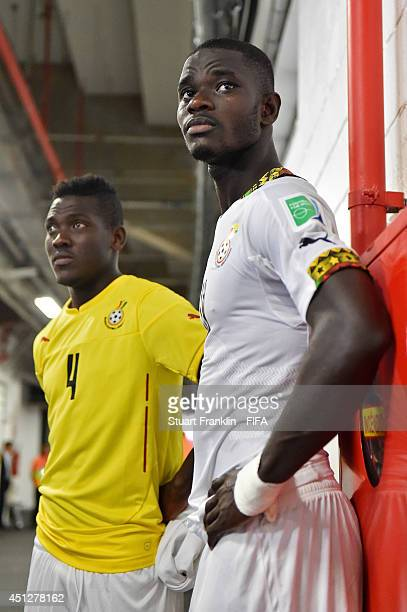 Daniel Opare and Jonathan Mensah of Ghana are seen in the tunnel after the 2014 FIFA World Cup Brazil Group G match between Portugal and Ghana at...