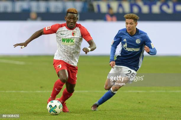 Daniel Opare of Augsburg and Amine Harit of Schalke battle for the ball during the Bundesliga match between FC Schalke 04 and FC Augsburg at...