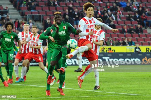 Daniel Opare of Augsburg and Yuya Osako of Koeln battle for the ball during the Bundesliga match between 1 FC Koeln and FC Augsburg at...