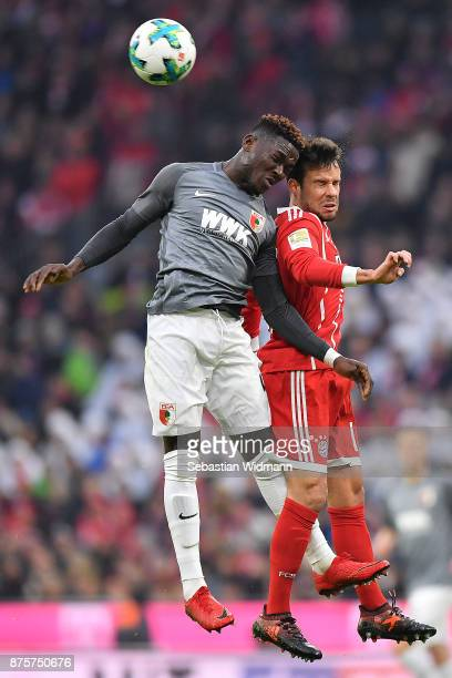 Daniel Opare of Augsburg fights for the ball with Juan Bernat of Bayern Muenchen during the Bundesliga match between FC Bayern Muenchen and FC...