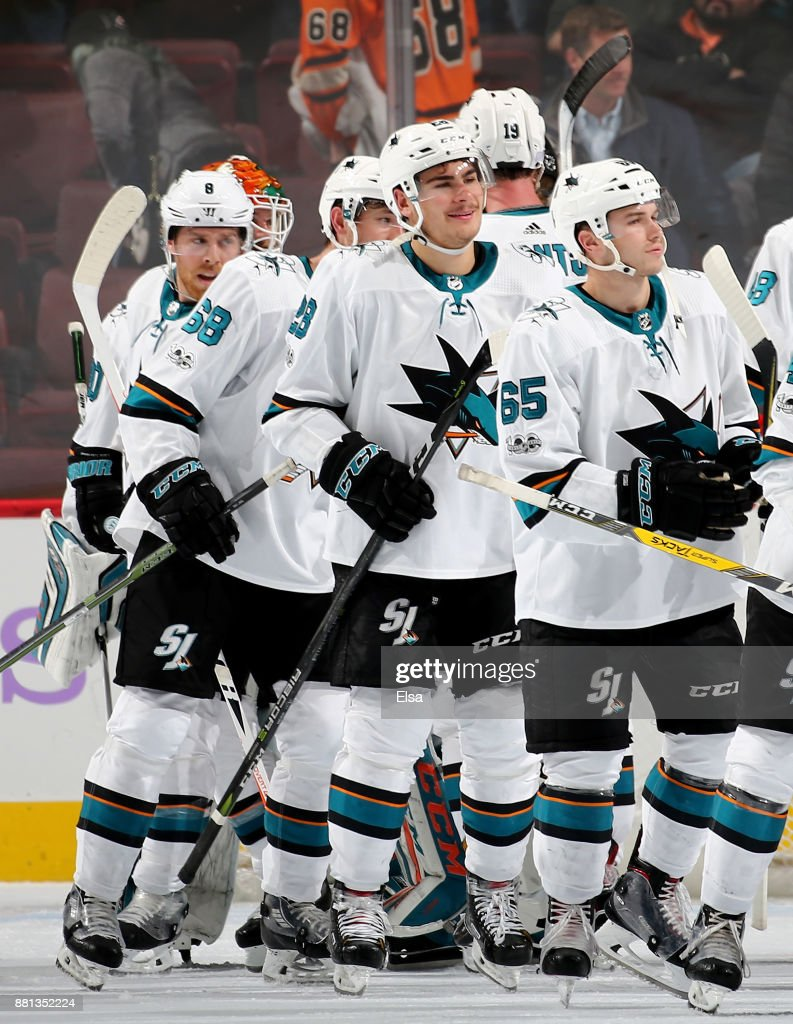 Daniel O'Regan #65 and Timo Meier #28 of the San Jose Sharks celebrate the 3-1 win over the Philadelphia Flyers with teammates after the game on November 28, 2017 at Wells Fargo Center in Philadelphia, Pennsylvania.