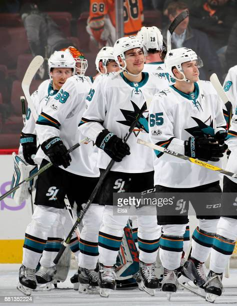 Daniel O'Regan and Timo Meier of the San Jose Sharks celebrate the 31 win over the Philadelphia Flyers with teammates after the game on November 28...
