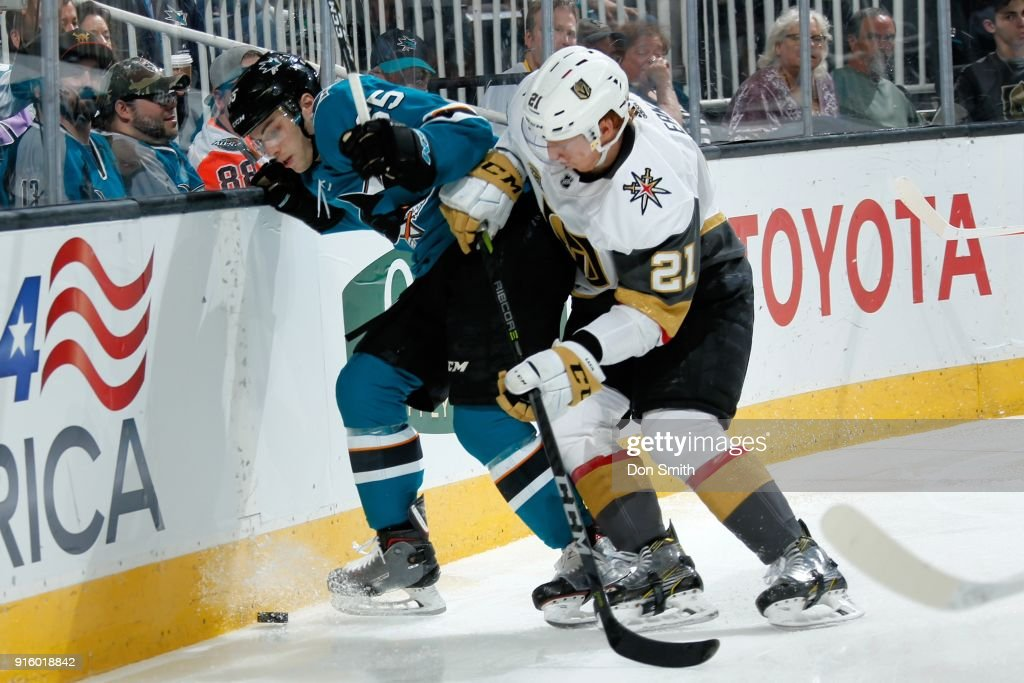 Daniel O'Regan #65 of the San Jose Sharks and Cody Eakin #21 of the Vegas Golden Knights battle for the puck along the boards at SAP Center on February 8, 2018 in San Jose, California.