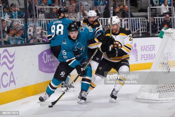 Daniel O'Regan of the San Jose Sharks skates with the puck against Jordan Szwarz of the Boston Bruins at SAP Center on November 18 2017 in San Jose...