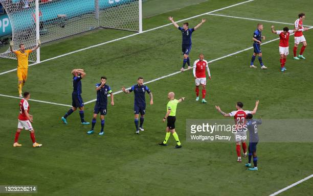 Daniel O'Shaughnessy of Finland and team mates react after Match Referee, Anthony Taylor awards a penalty during the UEFA Euro 2020 Championship...