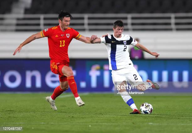 Daniel O'Shaughnessy of Finland battles for possession with Kieffer Moore of Wales during the UEFA Nations League group stage match between Finland...